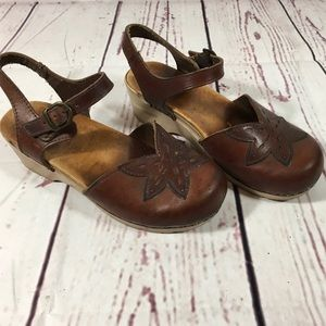 Dansko Brown Ankle Strap Clogs with Floral Detail